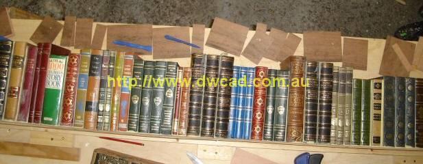 Preparing real books for prop bookshelf mould