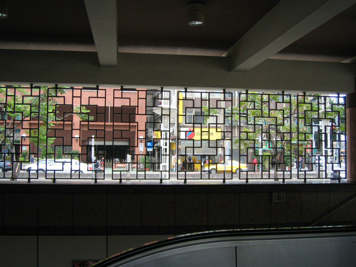 Another example of lattice window grilles used at a railway station