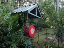 Tin roof for hose reel