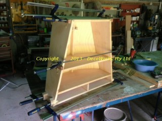 Cabinet frame clamped