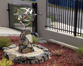 Completed garden armillary rock feature