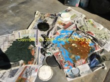 Drying paint tin contents on newspapers