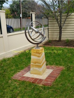 Stainless steel armillary sphere on front lawn