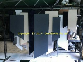 asymmetrical panel backdrop hanging in the support frame