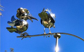 Stainless steel reproduction of tin bird mobile