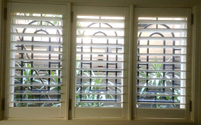 Arched security bars for kitchen window