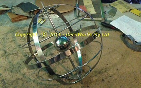 Assembled armillary with steel ball fitted inside