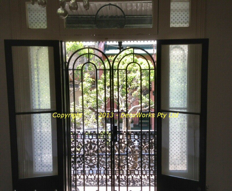 Double arched security doors